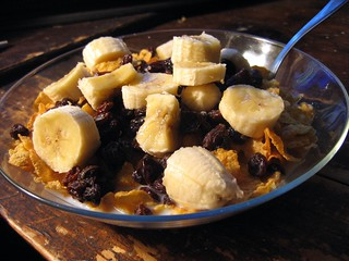 Cornflakes Topped With Bananas & Raisins. | by shutterberry