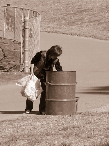 Homeless Woman searching for cans and bottles | by Franco Folini