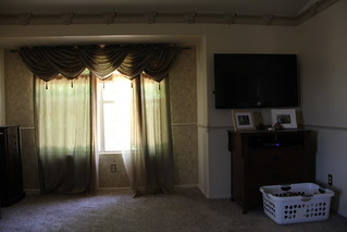 Master bedroom update: oh baby. That wallpaper and those drapes are awful | by africankelli