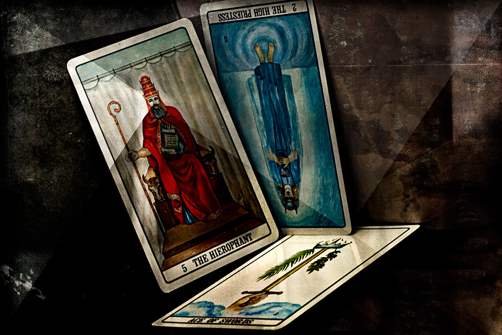 Tarot cards: The Hierophant, The Priestess, the Ace of Swords