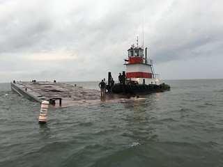 Photo of barge being sunk to provide an artificial reef