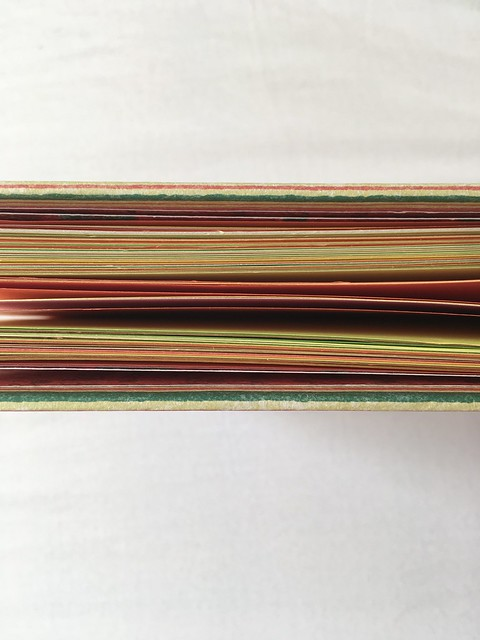 View of colourful book pages from above