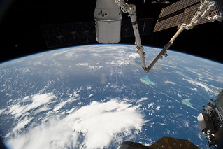 The SpaceX Dragon and the International Space Station orbit above the Bahamas | by NASA Johnson