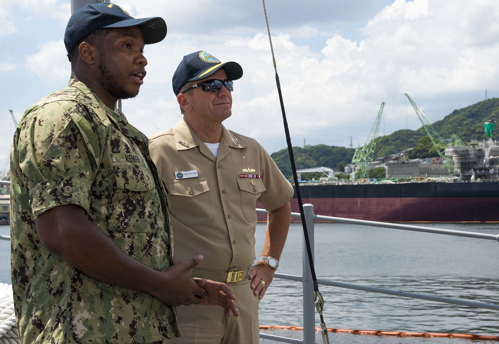 180801-N-VK310-0101 SASEBO, Japan (Aug.1, 2018) Mineman 3rd Class Nowell Kenner, a Sailor stationed aboard the Avenger-class mine countermeasures ship USS Patriot (MCM 7), speaks with Vice Adm. Rich Brown, Commander, Naval Surface Force, U.S. Pacific Fleet (CNSP) aboard Patriot. Brown's first visit to Sasebo as CNSP provided him the opportunity to engage the waterfront and discuss the future of the surface warfare community, the importance of command, and achieving success in the Surface Force by focusing on the following guiding principles of good stewardship, professional development and safety. (U.S. Navy photo by Mass Communication Specialist 2nd Class Michael Molina/Released)