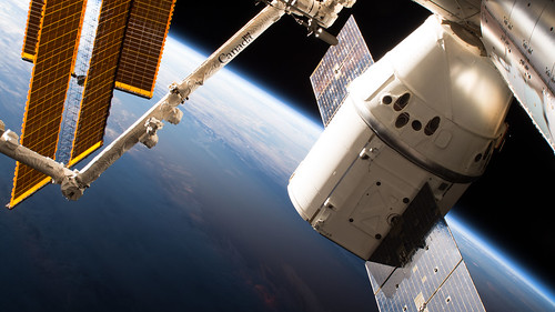The SpaceX Dragon cargo craft is pictured attached to the International Space Station's Harmony module | by NASA Johnson