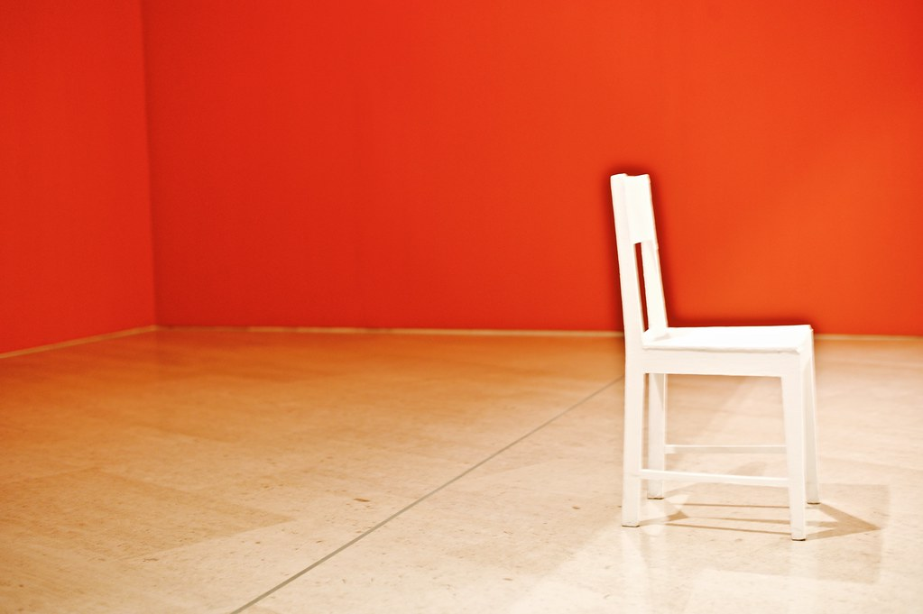 ... A Solitaire White Chair In A Room With Red Walls | By Pedrosimoes7