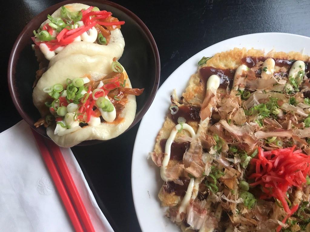 steamed pork buns and okonomiyake with chopsticks