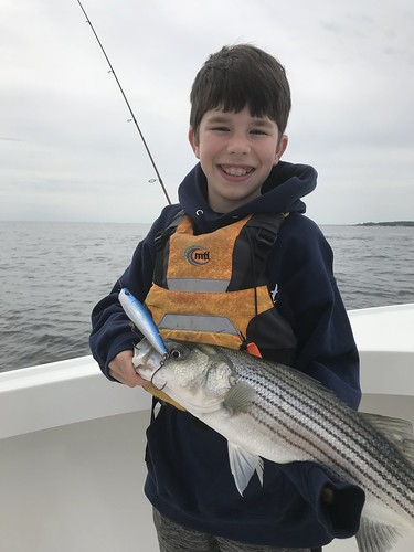 Boy holding striped bass