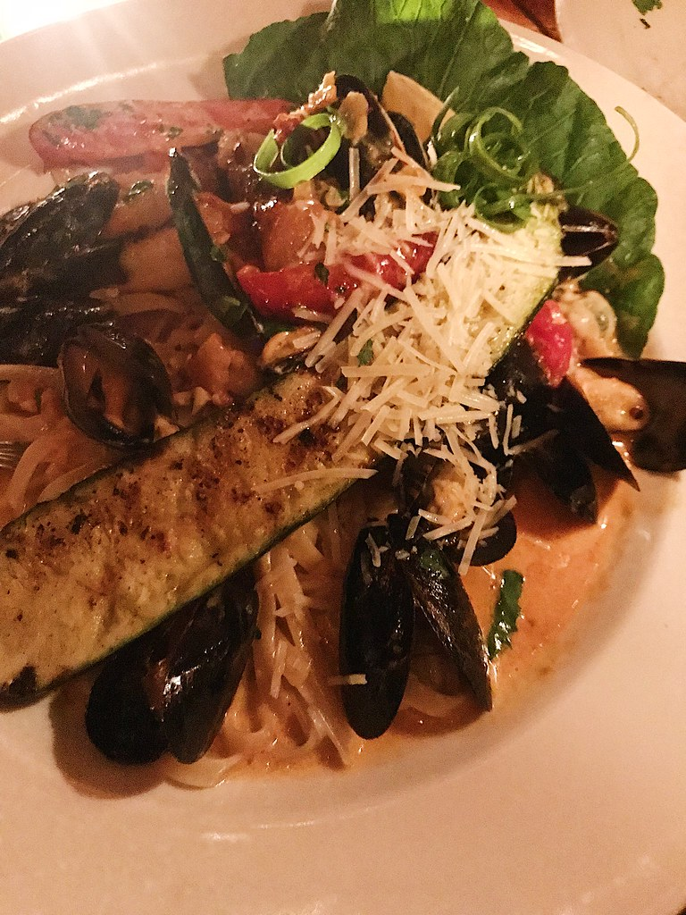 pasta with zucchini, cheese, mussels, and peppers