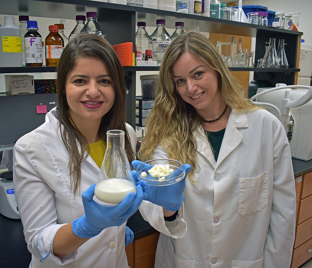 Mirian Silva-Cutini, left, and Dr. Vincia Biancardi display a sample of kefir