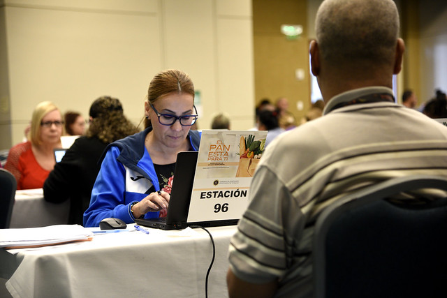 A program technician reviewing an applicant's eligibility for temporary Nutrition Assistance Program