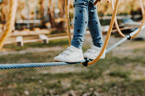 Young girl walking on rope in rope park. Legs detail | by wuestenigel