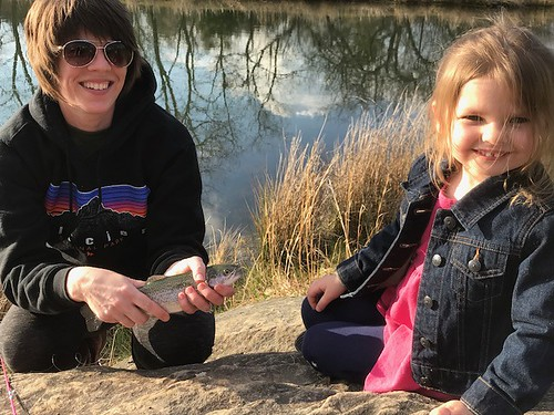 Photo of mom and daughter with a trout