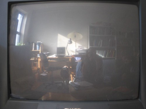 Part of living room reflected in the television yoon and for Parts of the living room