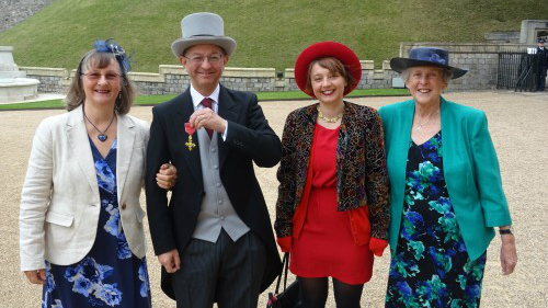 Professor Budd OBE collected his honour from the Queen at Windsor Castle. (Left to right: Professor Budd's wife Sue, Professor Chris Budd, his daughter Bryony, and his mother Jillian)
