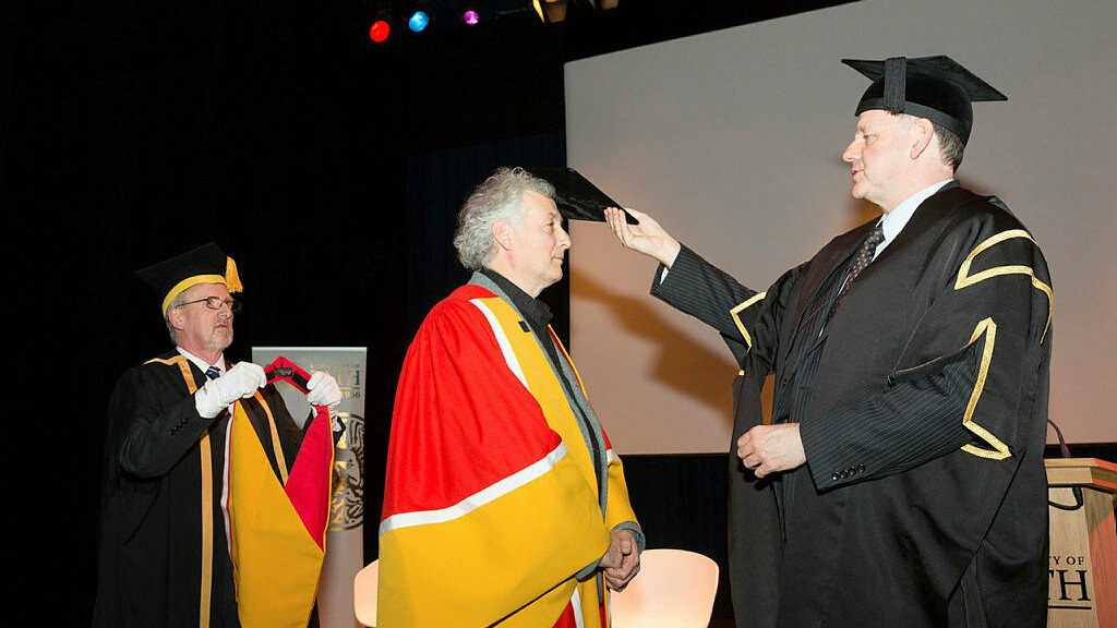 Mr Keith Bradley receives an honorary degree, conferred upon him by Deputy Vice-Chancellor Professor Bernie Morley.