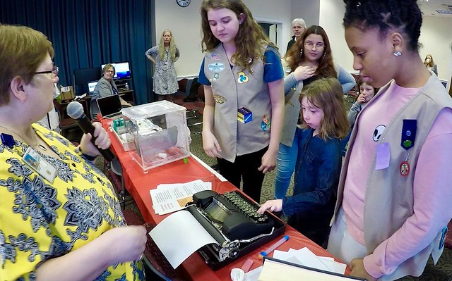 Girl Scouts trying old technology at a USDA Women in Ag STEM panel and demonstration