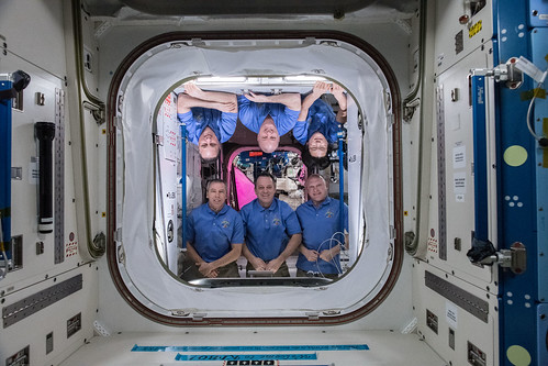 The six-member Expedition 55 crew poses inside the Harmony module | by NASA Johnson
