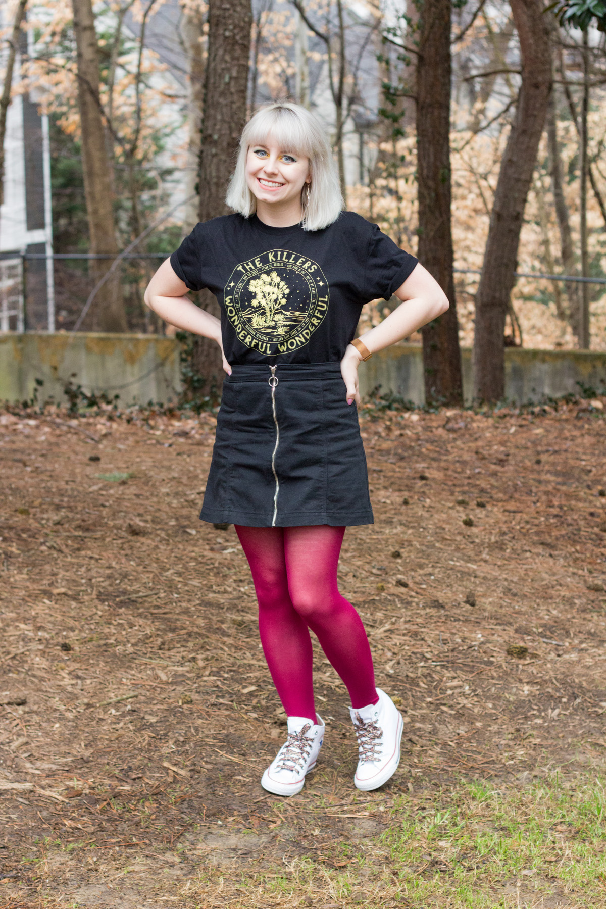 Styling a black concert t-shirt with a denim mini skirt and colorful tights