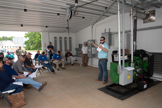 Jacob Petty discusses farm generators with poultry producers at Auburn University's National Poultry Technology Center