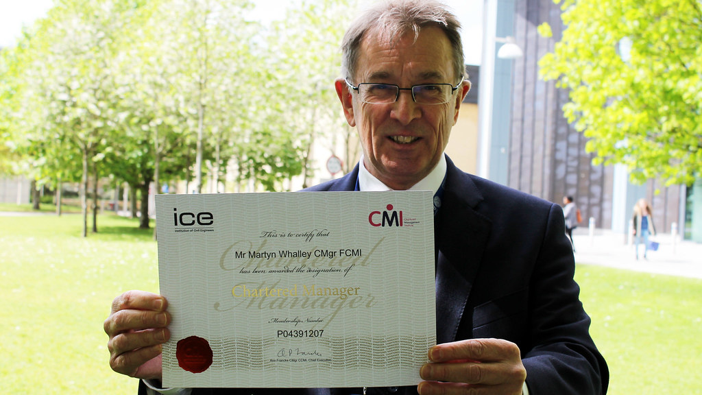 Martyn Whalley with his fellowship certificate