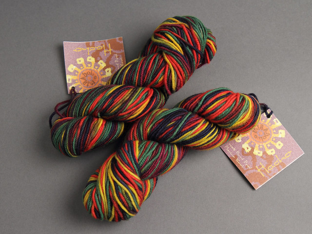 Destash yarn: Mirasol Hacho hand-dyed Merino wool DK 50g – 320 (red, green, navy, yellow)