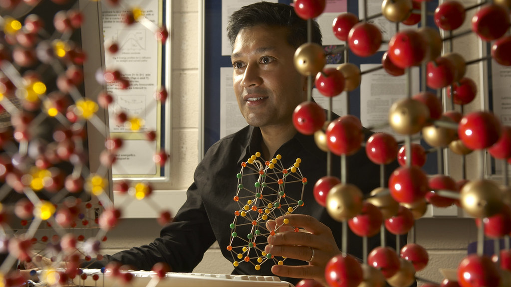Professor Saiful Islam with computer screen and chemical models