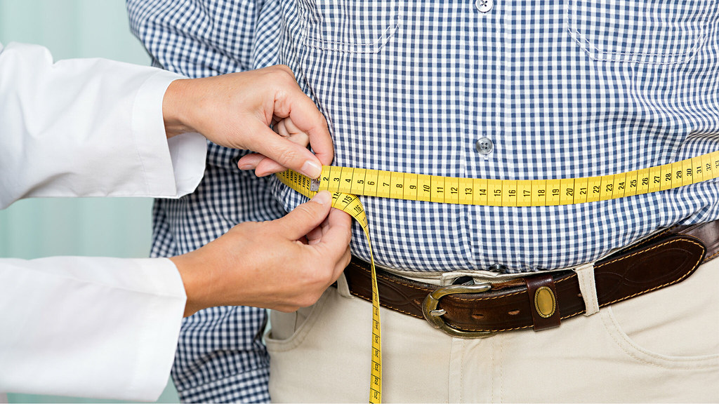 measurement tape around a man's waist