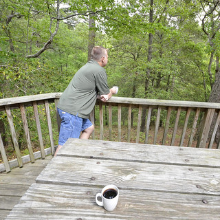 Enjoying coffee together at Cabin 6 at First Landing State Park | by vastateparksstaff