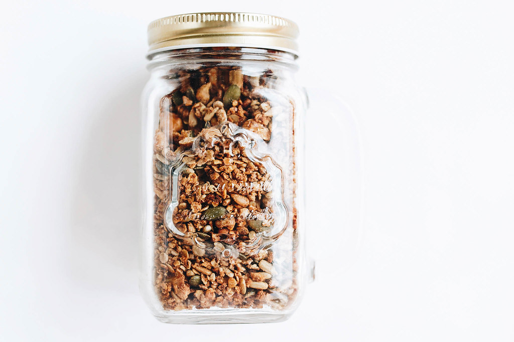 homemade granola in a jar healthy food on white backgroun flickr