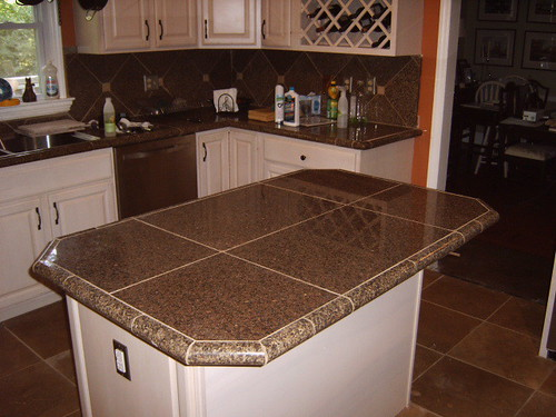 Kitchen remodel with Granite tile countertops and traverti ...