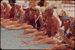 Residents of the Century Village Retirement Community Gather Around Pool for Daily Exercise Session. | by The U.S. National Archives