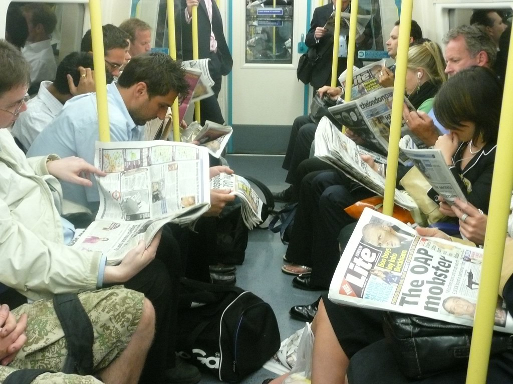 reading newspapers | they all have their newspapers. | tleilaxus