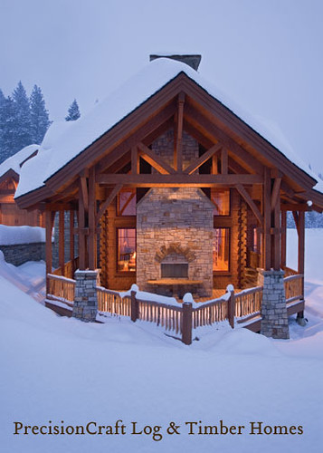 Snow covered exterior of a timber frame log home hybrid for Log a frame cabins