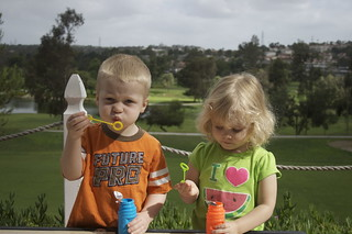 kenneth and paisley blowing bubbles | by katie.cupcake