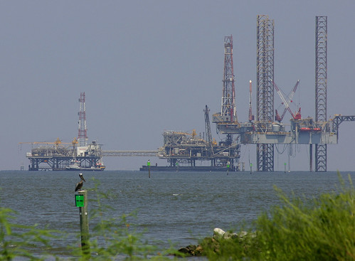 Pelican and gas rigs | by Write Pics