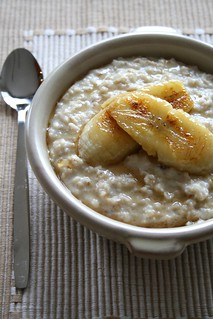 oatmeal with caramelized bananas and drizzling of maple syrup | by reya.