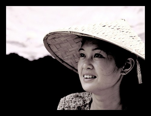 Woman with conical Asian hat at Menghai market, Yunnan, China | by Eric Lafforgue