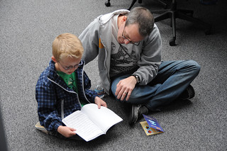 Son reads his book to his dad at the 4th Annual Children's Reading Celebration and Young Authors' Fair | by California State University Channel Islands