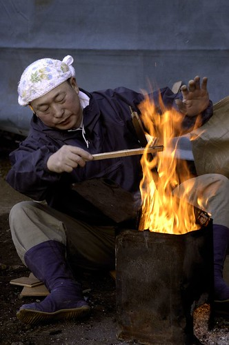 Japanese worker staying warm | by lindsayspix
