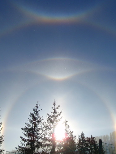 winter sun halo rainbow on a cold day with ice fog in skiw