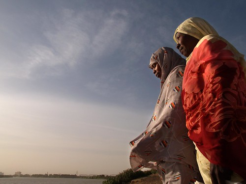 Two women look out over the White Nile | by World Bank Photo Collection