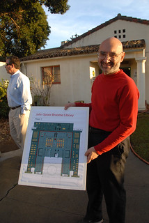 Paul Adalian holding the design plans for the Broome Library | by California State University Channel Islands