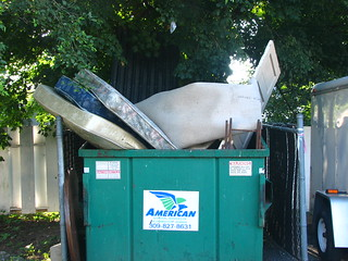 mattresses and door in garbage bin | by soundfromwayout