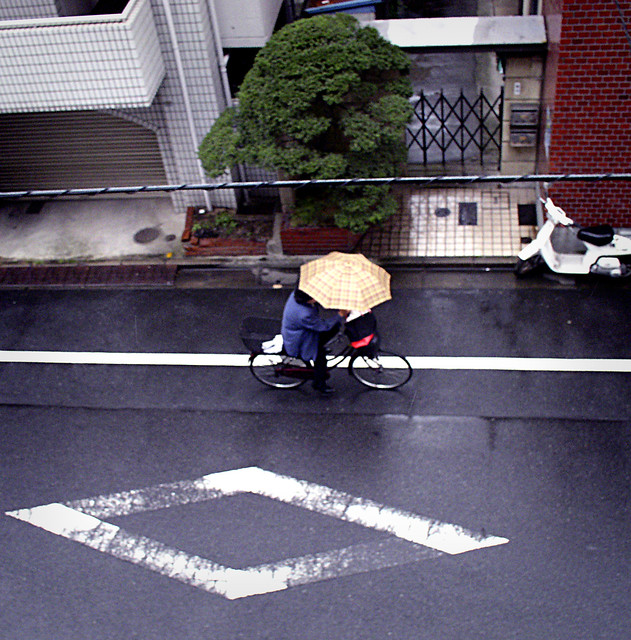 Rain Rider, Tokyo   Japanese of all classes bicycle everywhe