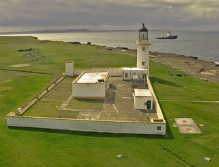 Stroma lighthouse orkney scotland with light tender  pharos in the backround | by calum57