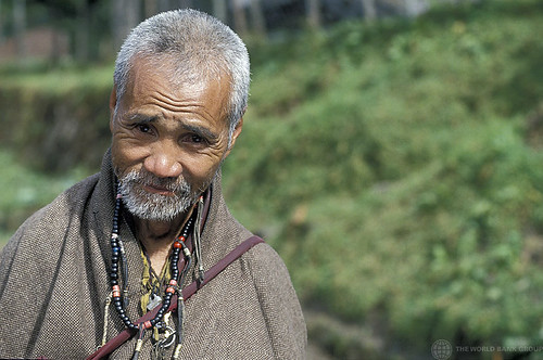 Portrait of elderly man in field. Bhutan | by World Bank Photo Collection