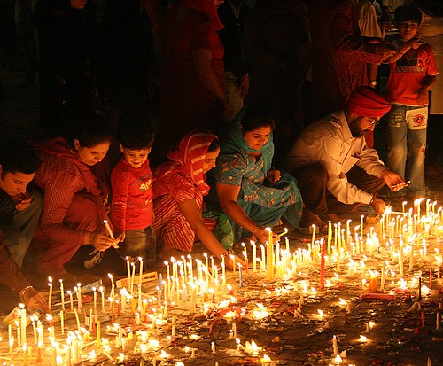 devotees_lighting_candles | by ramesh_lalwani