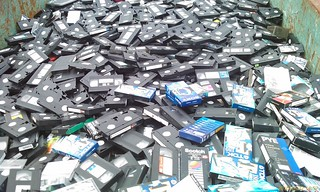 Skip containing discarded VHS tapes | by Rob Pearce