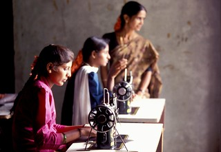 Young women being taught to use sewing machines | by World Bank Photo Collection